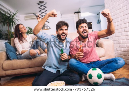 Group of multi national football fans cheering - Shutterstock ID 793757326