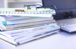 Group of multicolored office folders and glasses