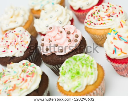 group of multicolored ornate details muffins white background