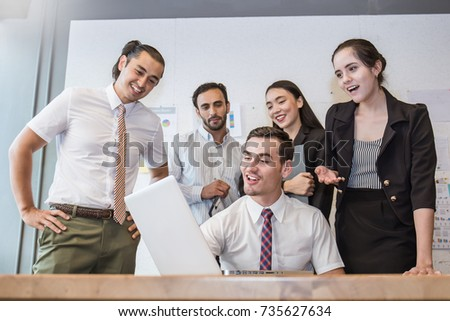 Group of multicultural employees talking and having fun in the business meeting, Elegant young business partners man and woman listening to colleague at meeting, banner or billboard business concept. #735627634