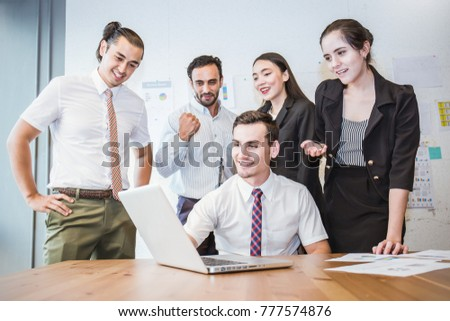 Group of multicultural employees talking having fun in the business meeting with computer, Elegant young business partners man and woman listening to colleague at meeting, banner  #777574876