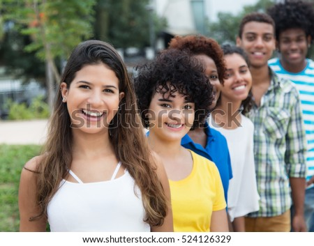 Group of multicultural young adults in a row outdoor in the city in the summer #524126329