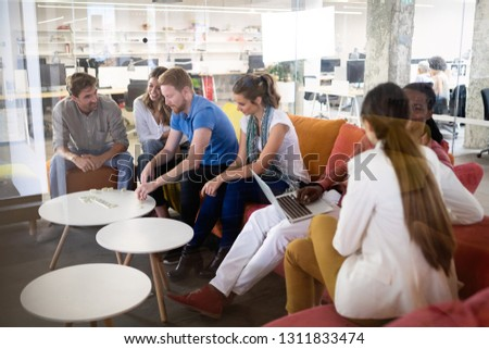 Group of multiethnic business people having corporate fun in office
