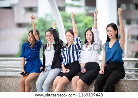 Group of Multiethnic Cheerful Female at City stree