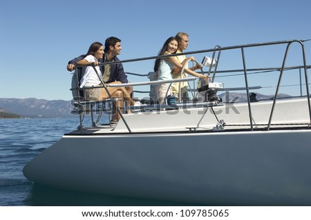 Group of multiethnic friends traveling on a sailboat