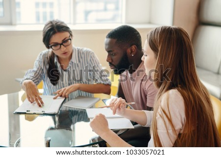 Group of multiethnic university students working together - education concept. #1033057021