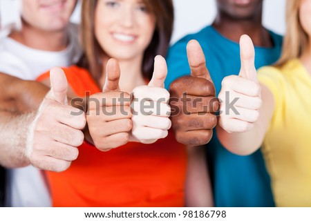 group of multiracial friends thumbs up - stock photo