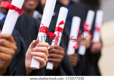 group of multiracial graduates holding diploma