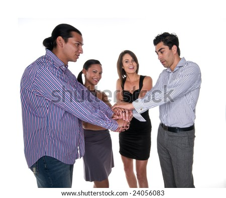 Group of multiracial young adults bonding hands together.