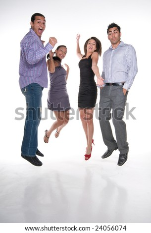 Group of multiracial young adults jumping and having fun in positive attitude.