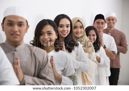 group of muslim asian men and...