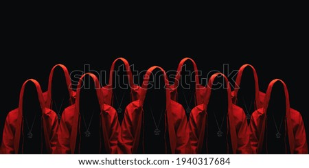 Group of mystery people in a red hooded cloaks. Isolated on black. Unrecognizable person. Hiding face in shadow. Ghostly figure. Sectarians. Conspiracy concept. Stock photo ©
