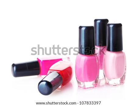Group of nail polishes isolated on white - stock photo
