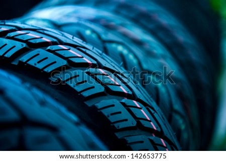 Group of  new tires for sale at a tire store. selective focus.