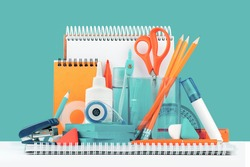 Group of office and school yellow orange and teal stationery on desk. Close up. Various supplies for back to school or education and craft concept. Selective focus. Copy space