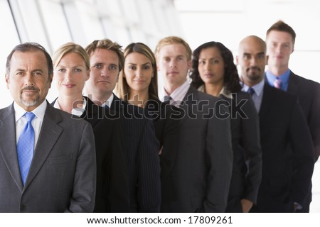 Group of office staff lined up facing camera