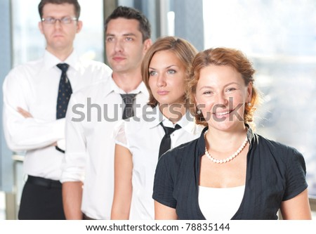 Group of office workers posing for camera