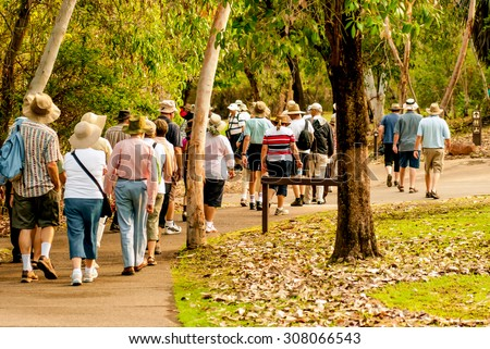 group of old and healthy people walking in the nature
