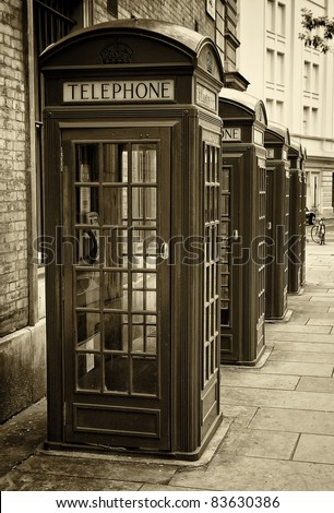 Group of old London phone cabins toned in sepia - stock photo