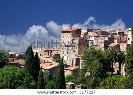Group of old traditional italian buildings ob the cloudy sky background, Tivoli, Italy