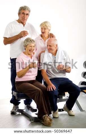 Group of older friends taking time out in the gym