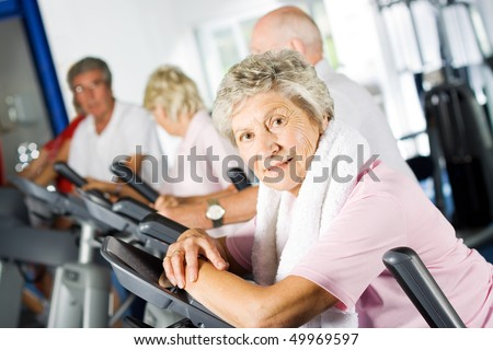stock photo : Group of older mature people exercising in the gym