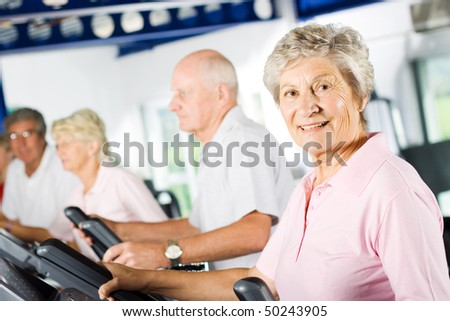 Group of older mature people exercising in the gym
