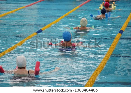 group of older women doing water aerobics in the pool