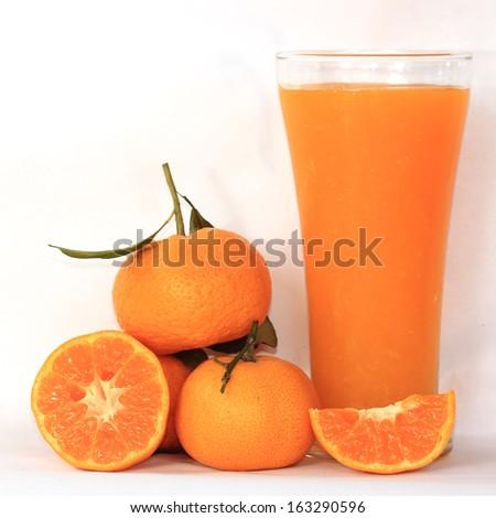 Group of orange and orange juice isolated on white