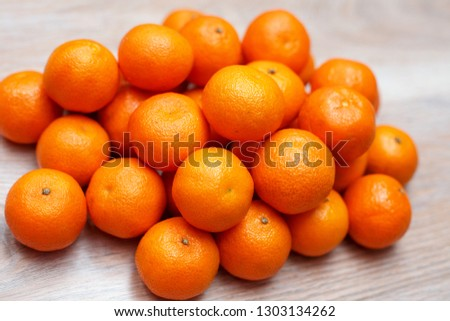 Group of orange clementine on wood table top view #1303134262