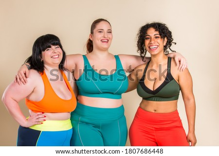 Group of 3 oversize women posing in studio - Beautiful girls accepting body imperfection, beauty shots in studio - Concepts about body acceptance, body positivity and diversity