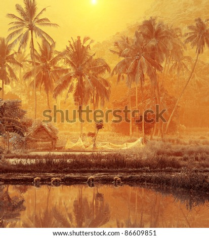Group of palm trees on yellow background