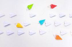 Group of paper planes in one direction and with one group individual pointing in the different way. Business for innovative solution concept.