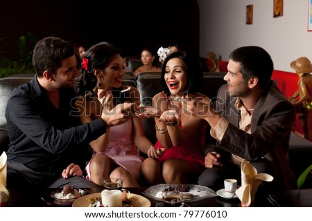 group of party lounge friends feeding young woman