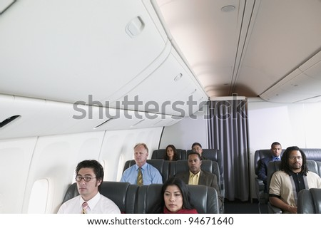 Group of passengers on airplane