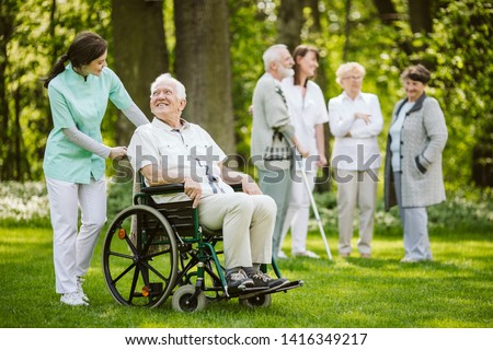 Group of patients and nurses in the nursing home