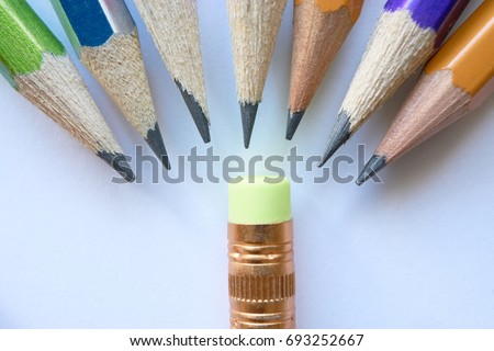 group of pencils standing in a semicircle humiliating small eraser. concept of a schoolchild in new school or bad pupils bully good pupil #693252667
