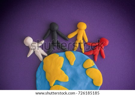 Shutterstock Group of people around the world. People and Earth are made out of play clay (plasticine).