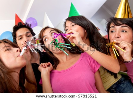Group of people at a birthday party having fun