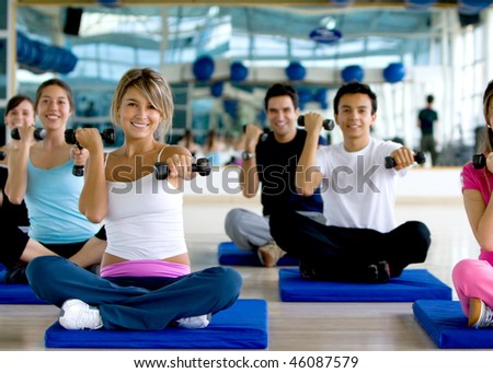Group of people at a gym class lifting free-weights