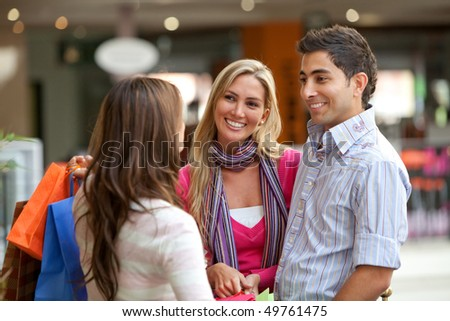 Group of people at a shopping center smiling - stock photo