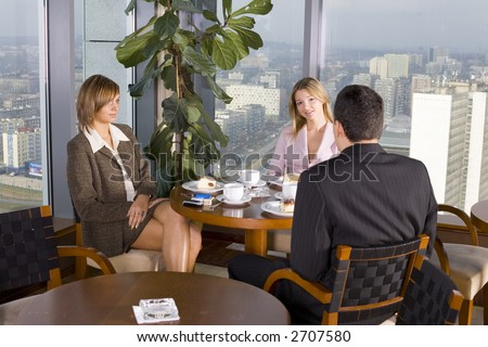 Group of People at the Cofe Table next to the Window (Big City View).