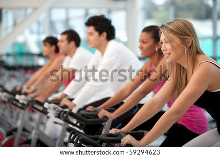 Group of people at the gym and smiling