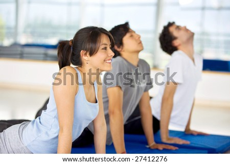 group of people at the gym doing yoga exercises