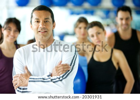 group of people at the gym with the trainer leading