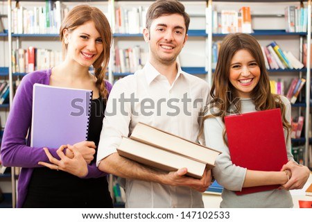 Group of people at work in a library