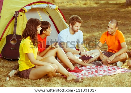 Group of People Camping and Telling Stories