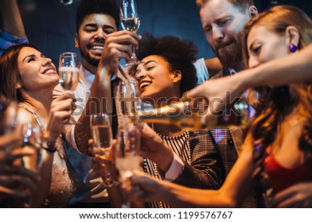 Group of people celebrating with champagne #1199576767
