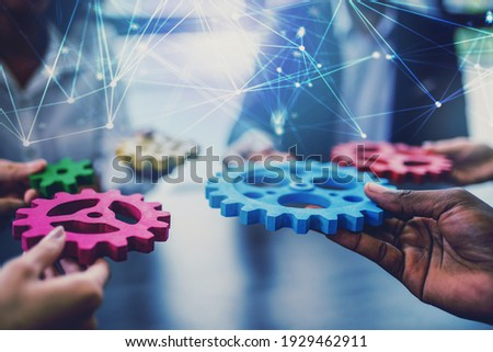 Group of people connect single colored cogwheels to make a gear. Teamwork, partnership and integration concept.