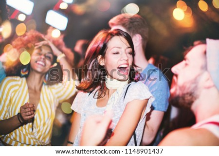Group of people dancing at concert. Side view. Horizontal. #1148901437